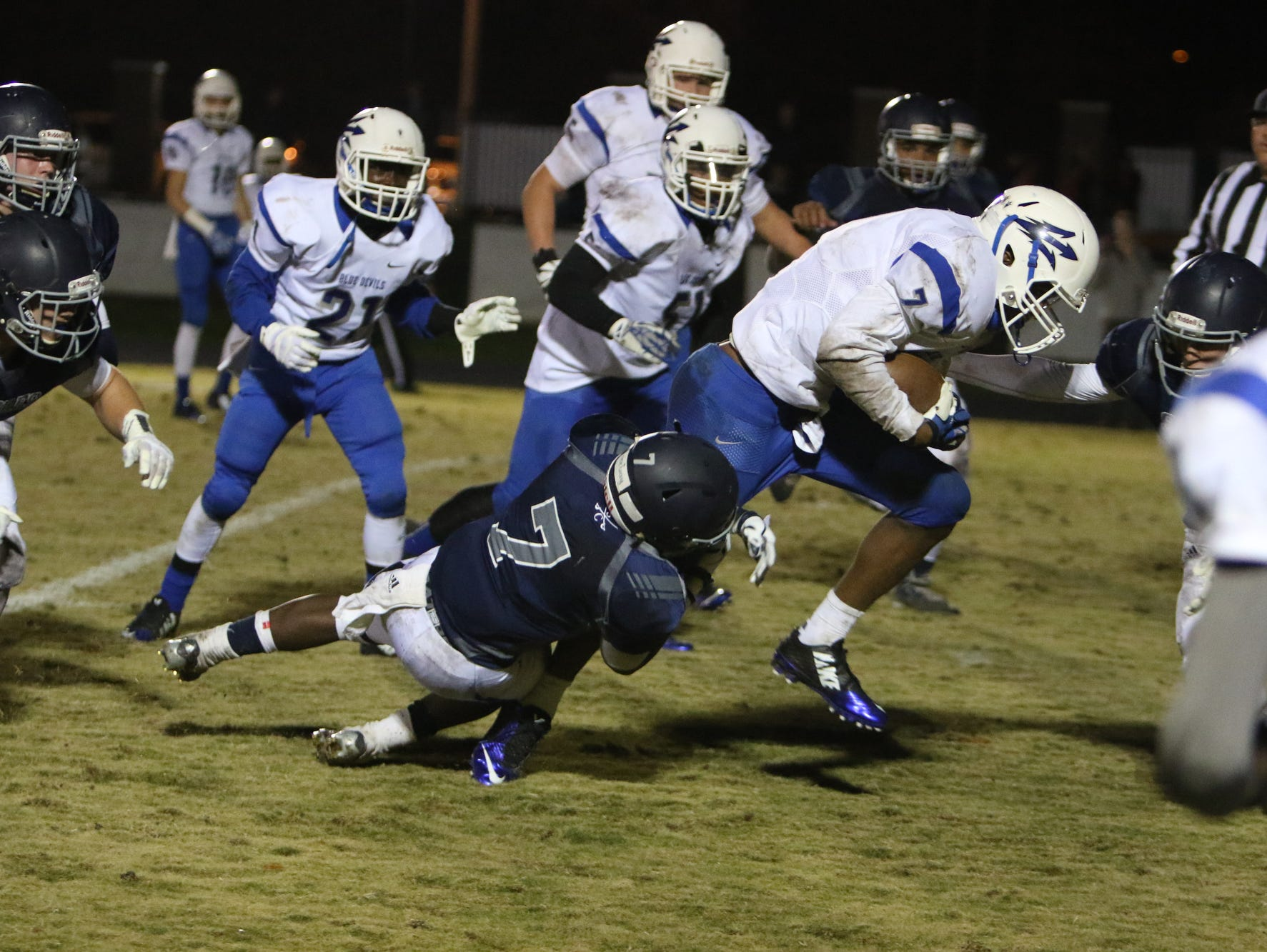 Southside Christian School's Quintyn Reeder(7) brings Williston-Elko's Shakur Chisolm(7) down. Southside Christian School hosted Williston-Elko High for the second round of the 1-A Playoffs.