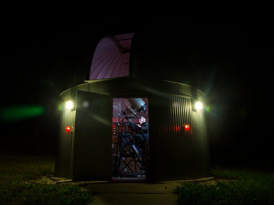Dr. Gerald D. Ruth assumes a familiar position in the IUS observatory, scanning the night sky.