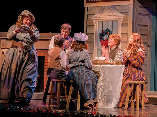 The Crachit family at Christmas dinner in Totem Pole Playhouse's production of Charles Dickens' 'A Christmas Carol.'