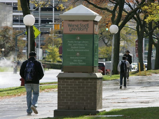 Students walk on the campus of Wayne State University in Detroit on Oct. 27, 2008.
