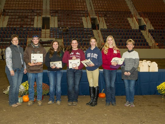 4-H members are recognized for passing Level 4 of the Horsemanship Skills Program. Pictured, from left, are: Penn State Extension Educator Donna Zang, of Butler County; Devin Campbell, of Butler County; Ashlynn Randolph, of Butler County; Olivia Cornell, of Columbia County; Cassidy Roadarmel, of Northumberland County; Morgan Wagner, of York County; and Tammy Clark, 4-H Horse Program Development Committee chair. Shane Sorg, of Butler County, was not available for the photo. The 4-H Horse Program Development Committee provided each ofthese members with custom belt buckles.