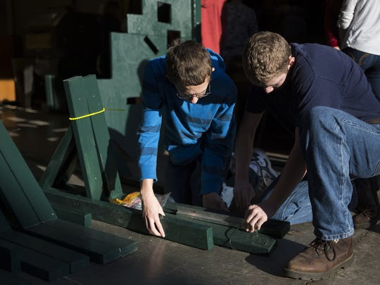 Dover Area High School students Brayden Herbst, left, and Jeremy Bentzel prepare a tactical target frame for transport. Students built the frame for the Pennsylvania Game Commission.