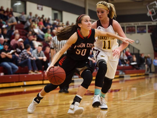 Ankeny's Codee Myers defends against Mason City's Megan Meyer during their game on Friday, December 04, 2015 in Ankeny. Mason City would go on to win 53-42.