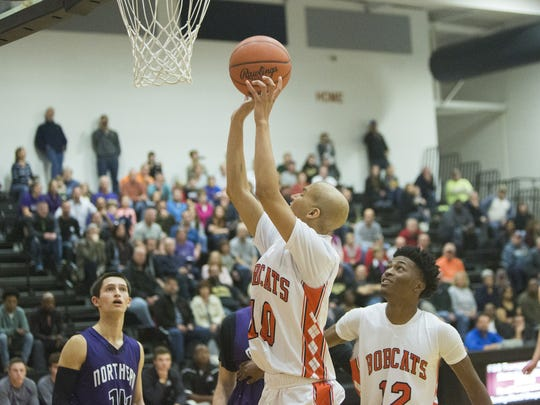 Northeastern's Marcus Josey makes the first basket