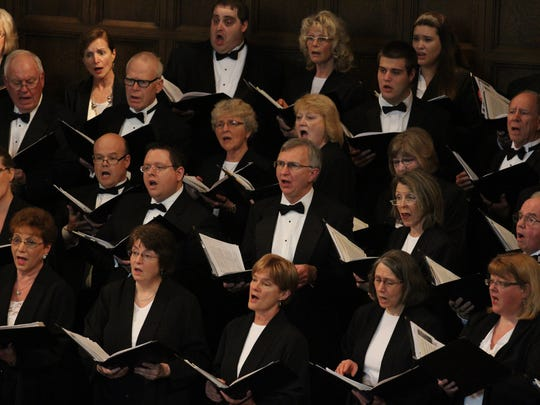 Choir members sing at the performance of the Wausau Lyric Choir in April 2013 at the First Presbyterian Church in Wausau.