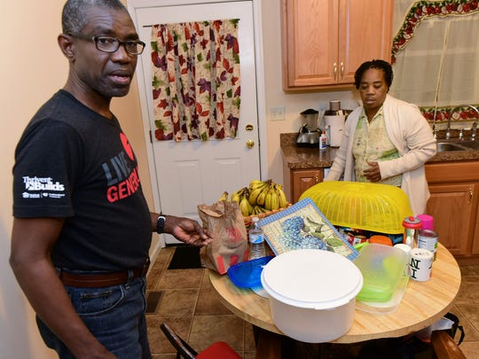 Alix Lewis and his wife, Marie Nicole spend time in their new Habitat for Humanity home in Guilford Township on Tuesday.