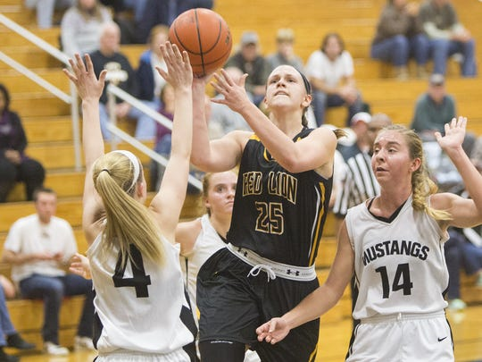Red Lion's Courtney Dimoff drives to the basket between South Western defenders Laykin Feeser, left, and Taylor Gough.