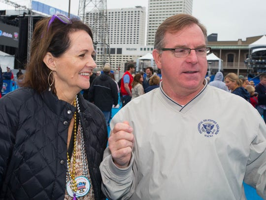 Pam and Chris Carson join thousands of fans in the French Quarter on New Year's Eve in anticipation of the Sugar Bowl.
