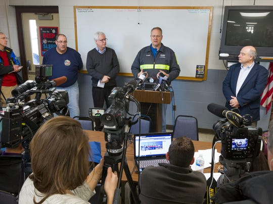 Cargill Mine Manger Shawn Wilczynski, center, speaks to the assembled media Thursday, Jan. 7, 2016, at the Lansing, NY Volunteer Fire Department after the rescue of 17 mine staff in Lansing, NY, Thursday, Jan. 7, 2016.