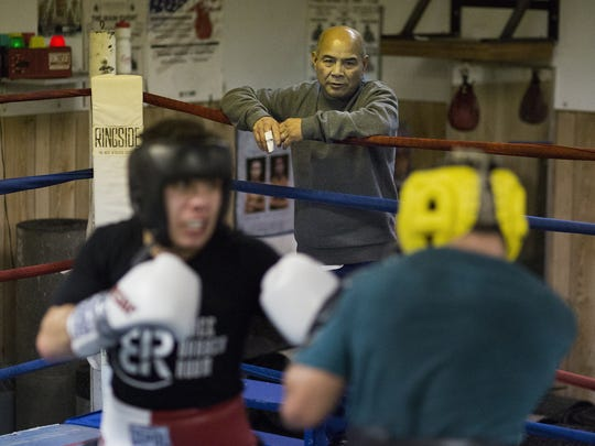 Trainer Julio Alvarez, 65, of Thomasville, top, watches as Josue Alfaro, 20, of New Oxford, left, and Alfredo Montanez, 33, of York, spar at Lincolnway Sportcenter. Both boxers will make their professional boxing debuts Saturday, Jan. 23 at the Hanover Armory.