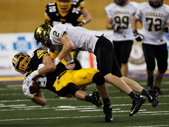 Bettendorf's Keaton Cain is tackled by Cedar Rapids,