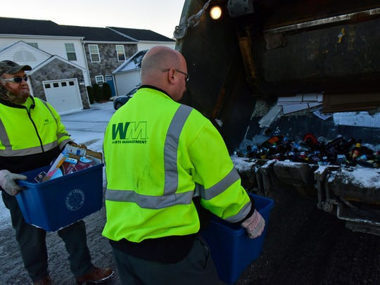 Paul Poe, left, and Jeff Walls, Waste Management, collect recyclables Wednesday morning, Jan. 13, 2016. To make it easy for Chambersburg's 11,000 utility customers to do just that, a new single stream recycle program is underway in the borough.