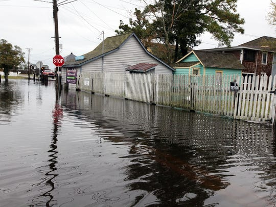Long Neck streets are flooded due to high water surges
