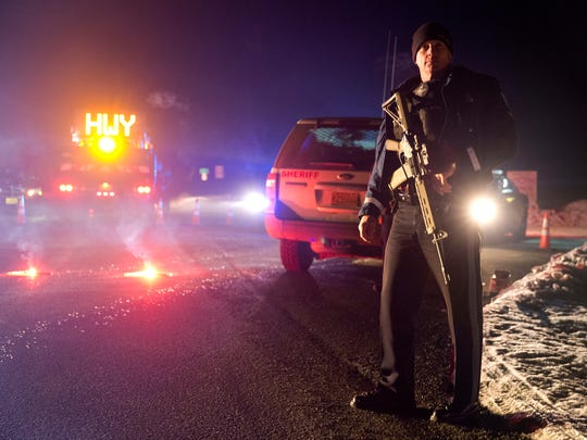 Sgt. Tom Hutchison stands in front of an Oregon State