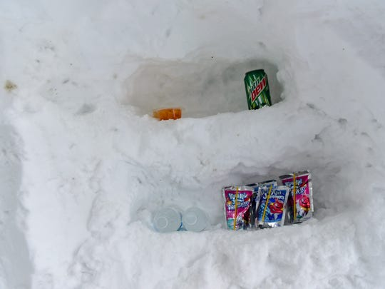 Drinks stay cool on shelves insode of a snow cave Skyler Cosey built in his yard Thursday, Jan. 28, 2016 in the 1400 block of Lincoln Way East, Chambersburg. The cave is complete with a skylight, TV and fireplace.