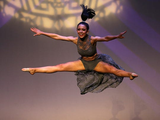 Courtney Pelot soars through the air during her talent