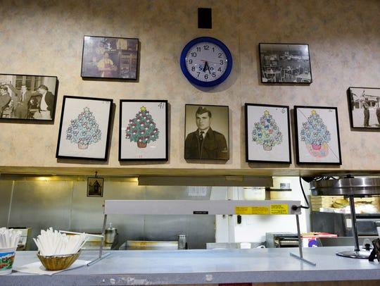 """Photos of Sotirios """"Sam"""" Drivas hang in his restaurant"""