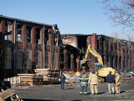 Crews began demolishing the Hesselson's warehouse on Prescott Avenue after a fire allegedly set by two 16-year-old males ripped through the mostly empty building January 31.