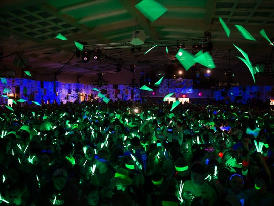Morale captains throw out glow sticks to the crowd