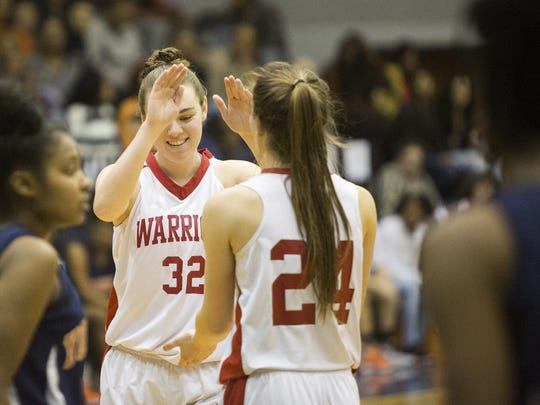 Susquehannock's Ashley Stone, left, congratulates her teammate Tyler Williams after Williams was fouled while scoring a basket. Susquehannock defeats William Penn 63-52 in a YAIAA girls' basketball quarterfinal at Dallastown Area High School, Saturday, February 6, 2016.