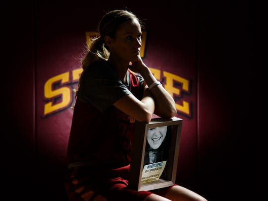Iowa State reserve player Lexi Albrecht poses for a portrait at the teams facility in Ames on Tuesday, Feb. 9, 2016. Albrecht lost her sister to cancer earlier this season and Iowa State will be a doing a pinkout game later this season for cancer awareness.