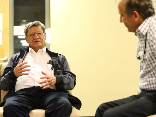 Gustavo Morales, left, talks with cardiologist and fellow military veteran Dr. Roger Belbel.