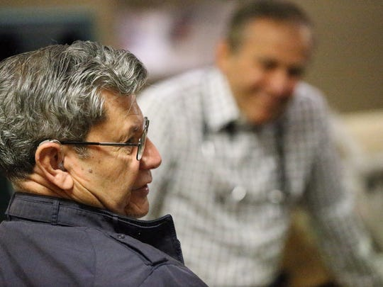 Gustavo Morales, left, a retired sergeant major and Vietnam veteran, talks about his quadruple bypass surgery as his friend, veteran and cardiologist, Dr. Roger Belbel, looks on.