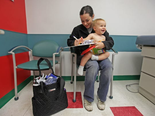 Melissa Skibo, of New Castle, holds 16-month-old son Evan at Nemours/Alfred I. duPont Hospital for Children in Rockland on Nov. 8, 2012. The hospital is funded by the vast fortune of late industrialist A.I. duPont, which also is supporting a growing health care operation in Florida.