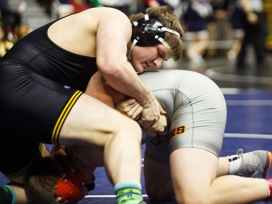 Ethan Andersen of Southeast Polk wrestles Tyler Pasker