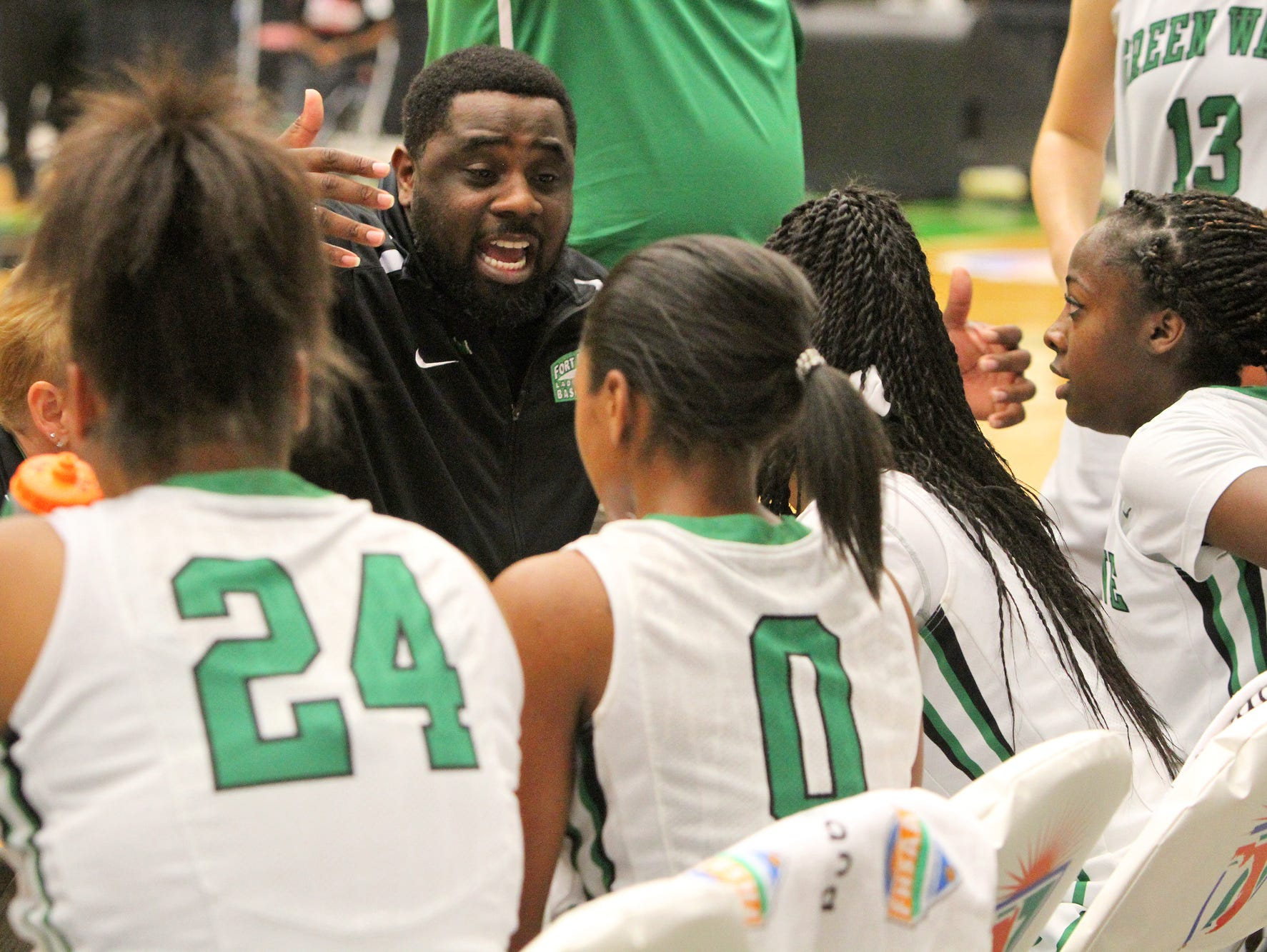 Fort Myers head coach Chad Terrell gives a pep talk to his team during a time out against Northeast during the FHSAA Girls 6A basketball finals Saturday February 20, 2016 in Lakeland, Florida. Fort Myers won the title 60-45. Photos by Cindy Skop 2016
