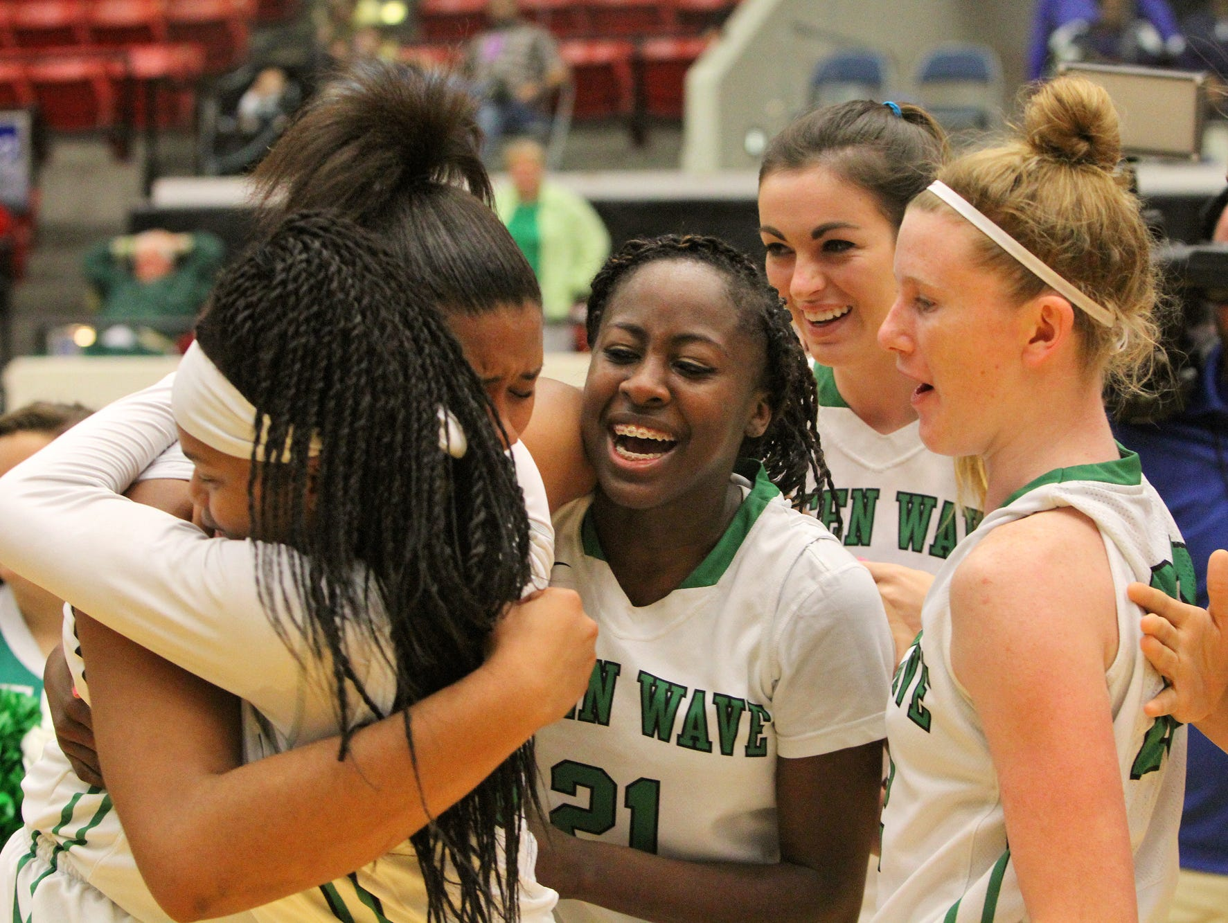 Fort Myers meets midcourt to celebrate winning the state title against Northeast during the FHSAA Girls 6A basketball finals Saturday February 20, 2016 in Lakeland, Florida. Fort Myers won the title 60-45. Photos by Cindy Skop 2016