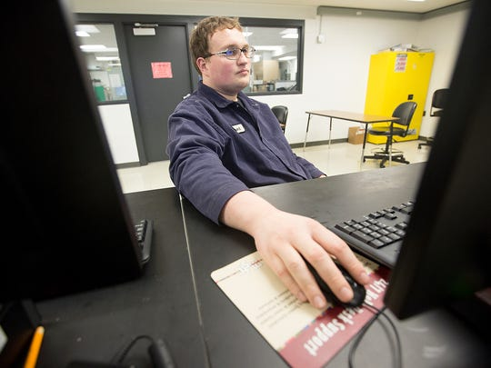 Rob Wunrow, 23, uses the computer program ControlLogix, which works with a process simulation device to control valves and motors at Mid-State Technical College in Wisconsin Rapids, Tuesday, Feb. 23, 2016. Wunrow works at Verso Corp. and is earning a specialized certificate at Mid-State Technical College.