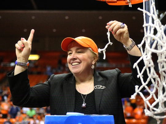 UTEP women's basketball head coach Keitha Adams cuts a piece of net off the rim after her team clinched the regular season Conference USA title with a 94-91 double overtime win over Charlotte on Saturday in the Don Haskins Center.