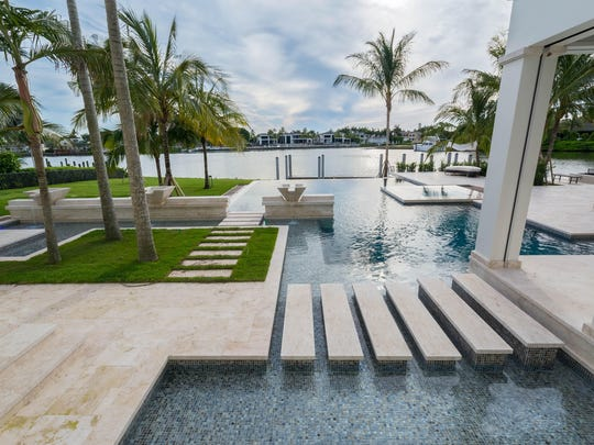 This three-tier spillover was created by Park Shore Pools for a private estate on the Gulf of Mexico in Port Royal in Naples. The top tier features an infinity edge that showers into a narrow trough before winding its way into the floor-level pool.