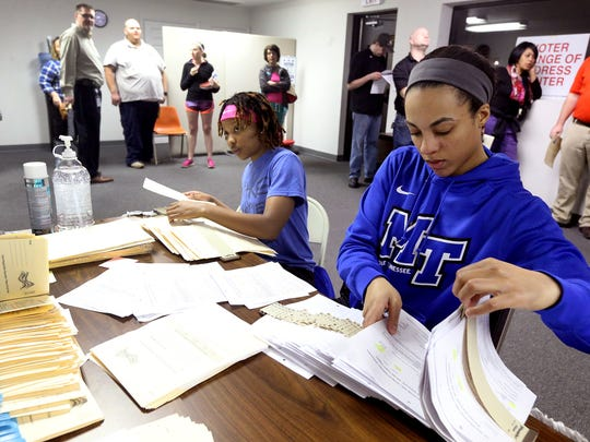 MTSU womens basketball players Ty Petty, left, and Brea Edwards, help out at the at the Rutherford County Election Commission Annex on Vine Street, in Murfreesboro on Election Day, Tuesday, March 1, 2016.