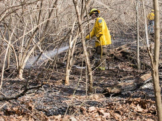 Firefighters put out a brush fire along Biesecker and KBS Rd. Tuesday Mar. 1, 2016 in Thomasville, Jackson, PA. Amanda J. Cain photo