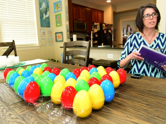 Melissa Russ displays eggs with special beeping devices