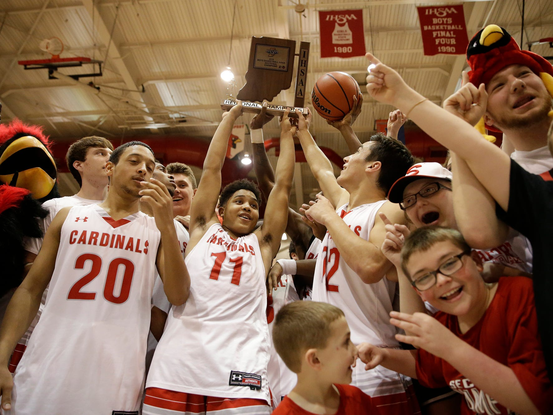 The Southport boys basketball team celebrates their regional championship against Terre Haute South at Southport High School in Indianapolis on March 12, 2016.