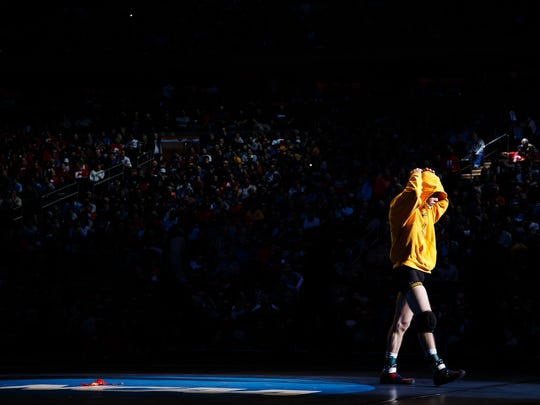 Iowa's Brandon Sorensen walks onto the matt before wrestling Penn State's Zain Retherford for their NCAA championship bout on Saturday, March 19, 2016 in New York City, New York. Retherford would go on to win 10-1.