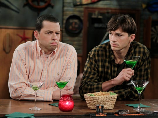 Ashton Kutcher, right, joined Jon Cryer to revive 'Two and a Half Men' after Charlie Sheen's departure.