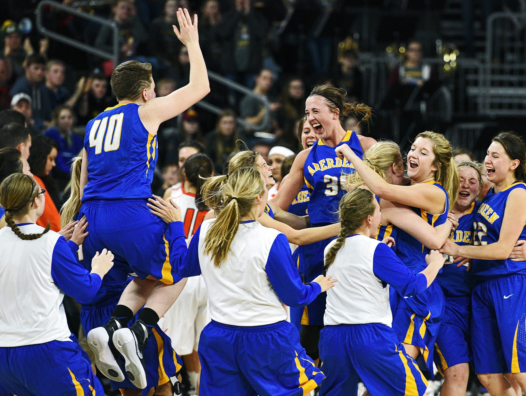 Aberdeen Central players celebrate their 75 to 64 victory over Washington in the South Dakota Class AA State Girls Basketball Tournament championship game Saturday, March 19, 2016, at the Denny Sanford Premier Center in Sioux Falls.