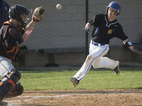 Central York catcher Joe Kroeger receives the ball as Waynesboro's Cody Cline comes home to score. Waynesboro defeats Central York 15-3 in baseball at Central York High School in Springettsbury Township, Friday, March 25, 2016.
