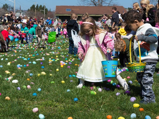 Kids in the 2-4 age group collect eggs at the ninth annual Hanover Community Easter Egg Hunt held at Moul Field in Hanover, PA on Saturday, March 26, 2016.