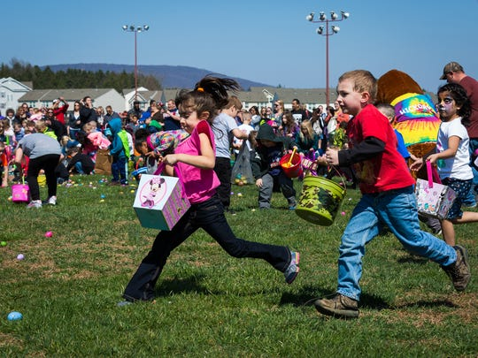 Kids in the 5-6 age group collect eggs at the ninth annual Hanover Community Easter Egg Hunt held at Moul Field in Hanover, Pa. on Saturday, March 26, 2016.