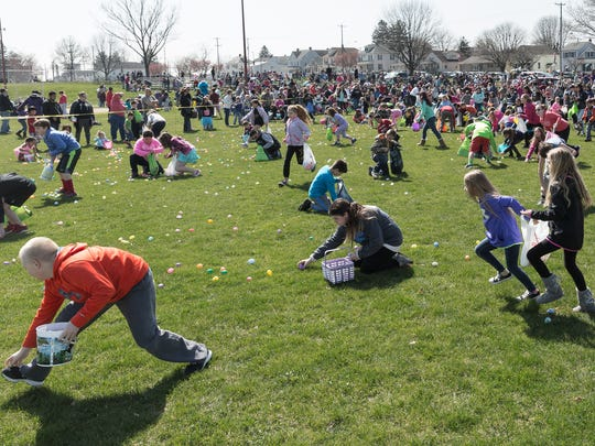 Kids in the 9-10 age group collect eggs at the ninth annual Hanover Community Easter Egg Hunt held at Moul Field in Hanover, Pa. on Saturday, March 26, 2016.