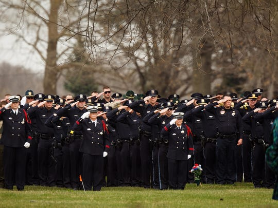 Police officers, family members and supporters gather