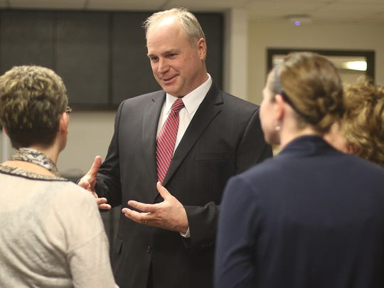 Superintendent finalist Larry Ouimette talks to members of the public during a meet and greet at Bliss Educational Services Center in Stevens Point, Tuesday, March 29, 2016.