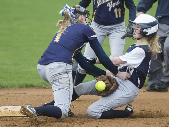 West York's Amanda Prowell slides safely into second base as the ball gets away from Eastern York's Kierstin Grove. Eastern York defeats West York 4-2 in softball in West York, Monday, April 4, 2016.