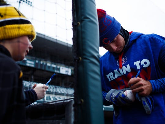 The Iowa Cubs Albert Almora Jr. signs an autograph during an open workout at Principal Park on Wednesday, April 6, 2016, in Des Moines.
