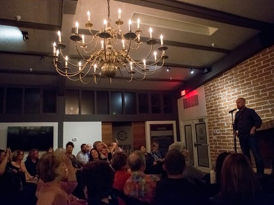 Austin King speaks at the Arizona Storytellers Design and Architecture show at Changing Hands First Draft Book Bar on Wednesday, April 6, 2016, in Phoenix, Ariz.